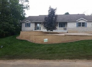 retaining wall, fire pit, walkway with crushed stone