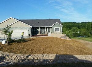 Retaining walls, erosion matting, erosion control, plantings, stone