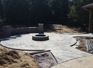 Patio, outdoor lighting, pillars, stone caps, fire pit, sod and plantings