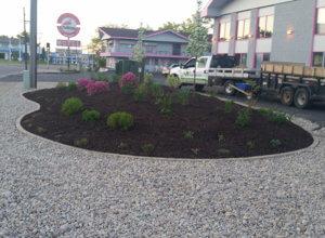 Plantings, mulching, berm, edging, stone