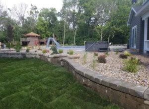 Sodding, retaining walls, plantings bushes, trees, edging